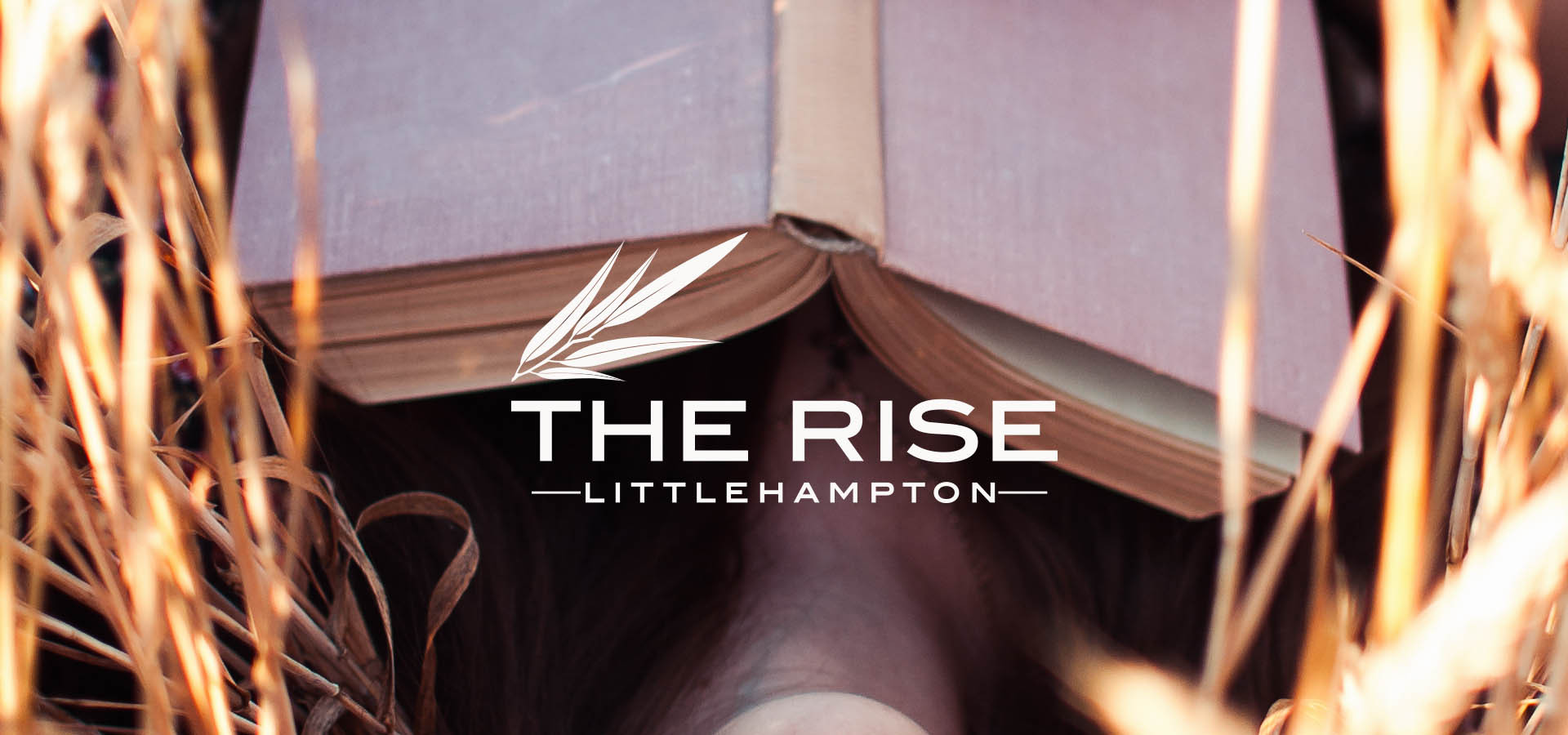 the rise littlehampton book in field slider with logo